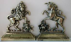 pair of antique brass and unicorn chimney