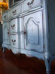 distressed and aged french country buffet in a french country blue