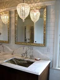 chandelier lighting over vanity in bathroom interiordesignew com