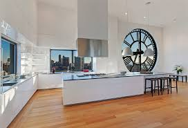 open kitchen plans with island clock tower apartment glossy white open plan kitchen with island
