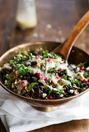 pomegranate kale and rice salad with walnuts and feta