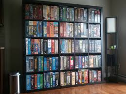 furniture black ikea expedit bookcase filled with movies files on