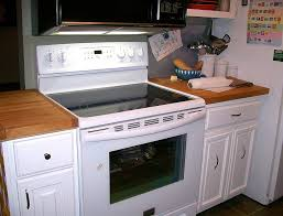 gray kitchen cabinets white appliances why white kitchens stand the test of time kitchen tips