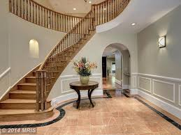 traditional staircase with chair rail u0026 balcony in bethesda md