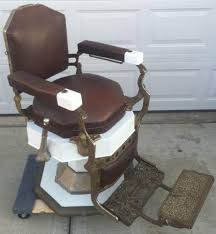 Old Barber Chair Antique Barber Shop Chairs Poles And Related Vintage Fixtures