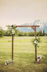 wedding arbor used scenic alaska inn wedding wooden arch white roses and greenery