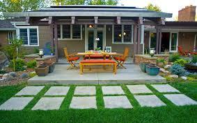 contemporary concrete steppers leading into outdoor dining space