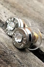 bullet stud earrings silver bullet studs with crytals in the middle of each earring