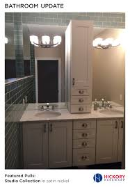 bathroom update with mint colored tile white shaker cabinets and