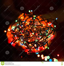 New Year Lighting Decorations by Female Hands Holding Multicolored Christmas Light Decorations On