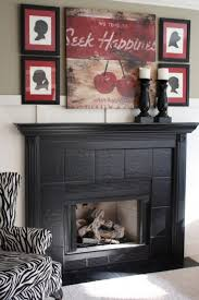 adorable painted tile fireplace surround using black paint color
