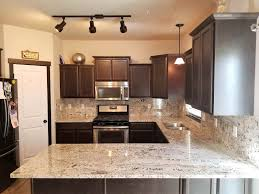 white kitchen countertops with brown cabinets 20 granite kitchen countertops for every type of decor