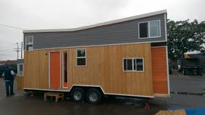 tiny giant house on wheels with onboard chicken coop