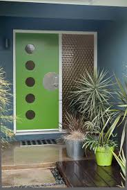 the green door and potted plants make this mid century modern