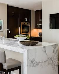 kitchen island with marble top marble waterfall island modern kitchen elms interior design