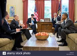 president barack obama meets with senior advisors in the oval
