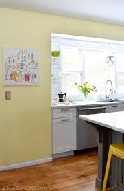 yellow kitchen walls white cabinets kitchen renovation reveal resources burger design llc