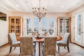 traditional dining room with breakfast nook by sunrise building