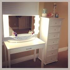 small white makeup vanity table with drawer and square lighted