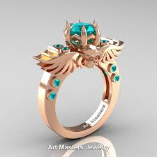 rose zircon rings images Art masters jewelry winged skull 14k rose gold 1 0 ct blue zircon jpg