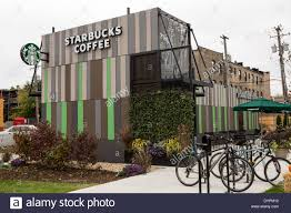 starbucks coffee shop built out of recycled shipping containers in