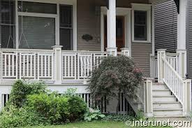 porch with wood railing interunet