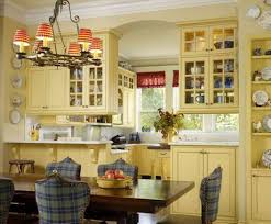 traditional kitchen with yellow kitchen cabinet paint colors