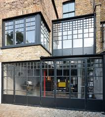 double height crittall style glazed extension with a single spine