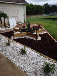 Lava Rock Landscaping by Star Flower Bed Surrounded By Red Lava Rock And High Lighted With