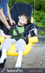 handicap swing disabled five year boy in handicap swing picture