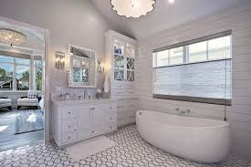 egg shaped tub with black and white oval tile floor transitional