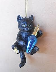black kitten with blue bulb cat tree