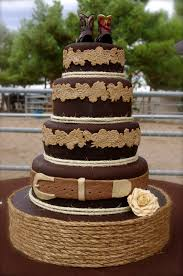 western wedding cake with twine and boot toppers western
