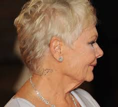 dame judi dench sports 007 tattoo at the premiere of the new james