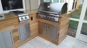 WoodLook Tile Outdoor BBQ Kitchen Modern Patio Miami By - Outdoor bbq kitchen cabinets