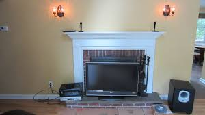 Mounting A Tv Over A Gas Fireplace by Newtown Ct Mount Tv Above Fireplace Home Theater Installation