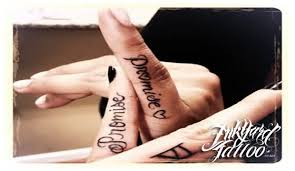 coolest small heart and black ink promise friendship tattoo