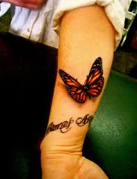 collection of 25 butterfly designs on forearm