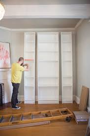 How To Build A Wall Mounted Bookcase Laura U0027s Living Room Ikea Billy Bookshelves Hack The Makerista