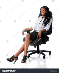african american businesswoman sitting on office stock photo