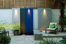 gap gardens small urban courtyard garden with painted feature
