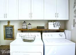 table over washer and dryer shelf above washer and dryer floating shelves laundry room storage