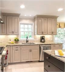 crown moulding on kitchen cabinets taupe kitchen cabinets love the dark stain color on the island
