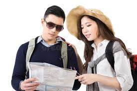 Young asian couple travelers looking the map stock photo image