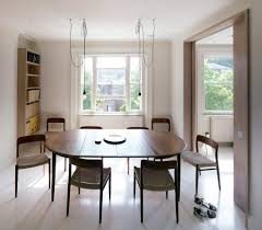 london saarinen oval dining table room contemporary with pendant