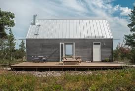 leva husfabrik cabin wood facade grey architecture www