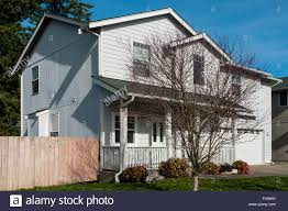 two story house in a suburban neighborhood stock photo royalty