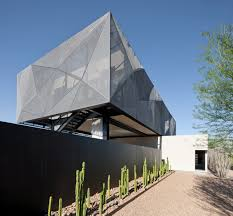 modern house in the desert full of dramatic art indoor outdoor