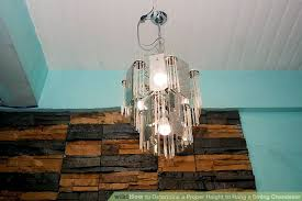 How High To Hang Chandelier How To Determine A Proper Height To Hang A Dining Chandelier