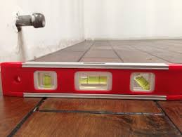 Installing Base Cabinets On Uneven Floor How Important Is A Level Kitchen Floor